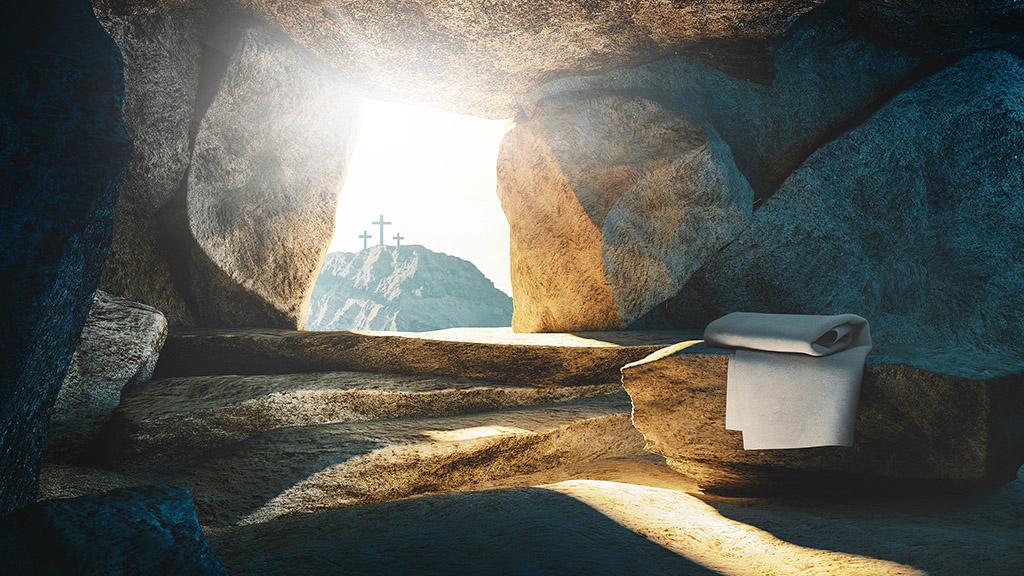 Foto av den tommegraven og korset i bakgrunnen - påskens budskap.
